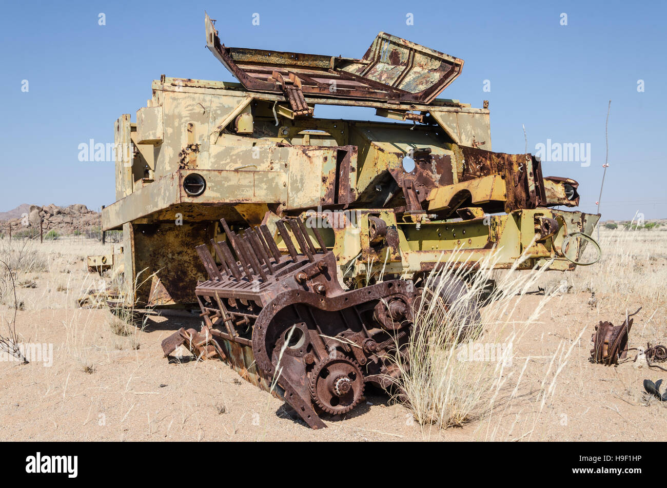 Abandoned harvester rusting away deep in the Namib Desert of Angola - Stock Image