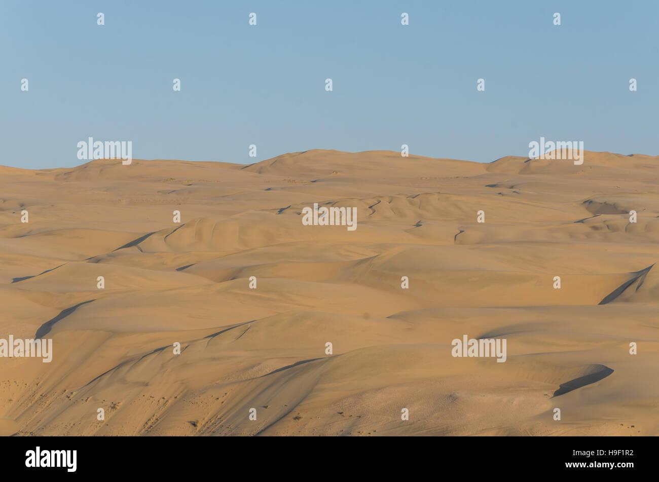Impressive towering Namib Desert sand dunes of Angola and Namibia - Stock Image