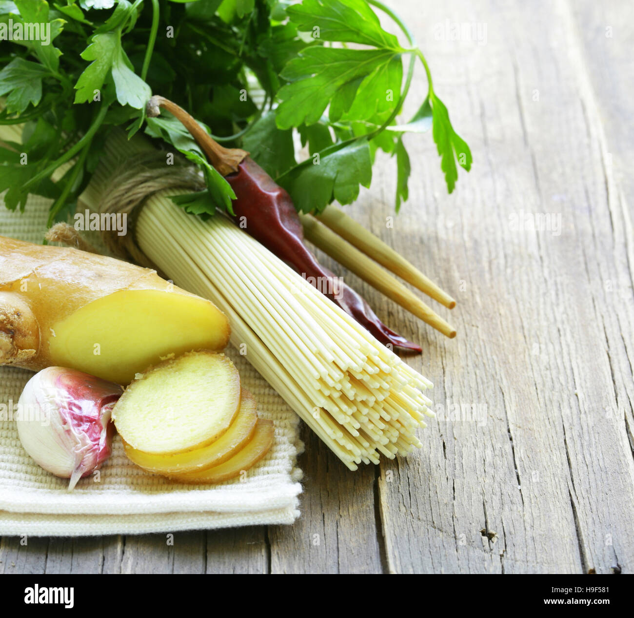 traditional Asian noodles on a wooden table - Stock Image