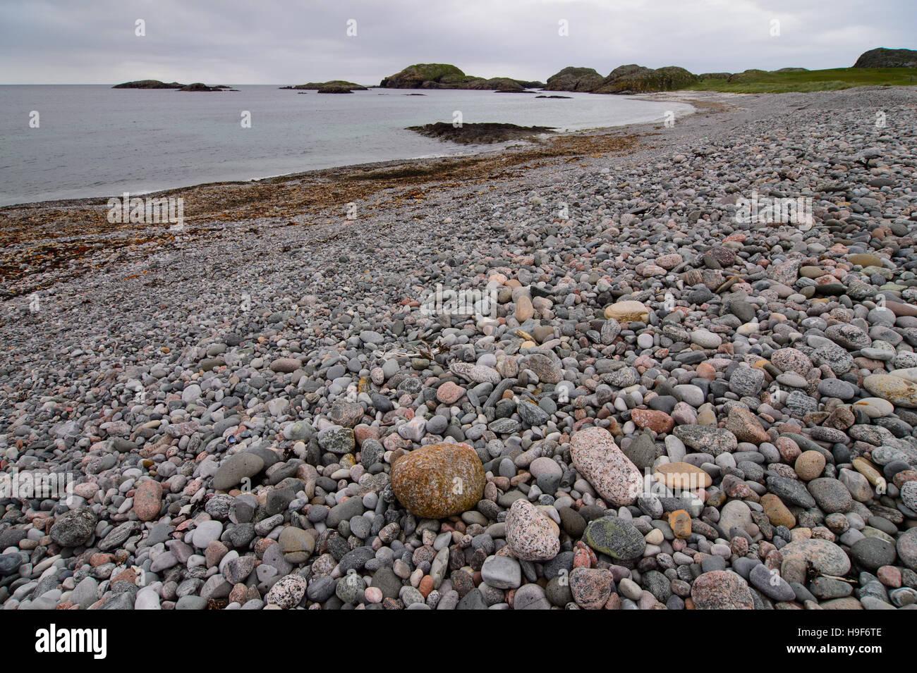 Pebble beach on Isle of Iona, Scotland - Stock Image