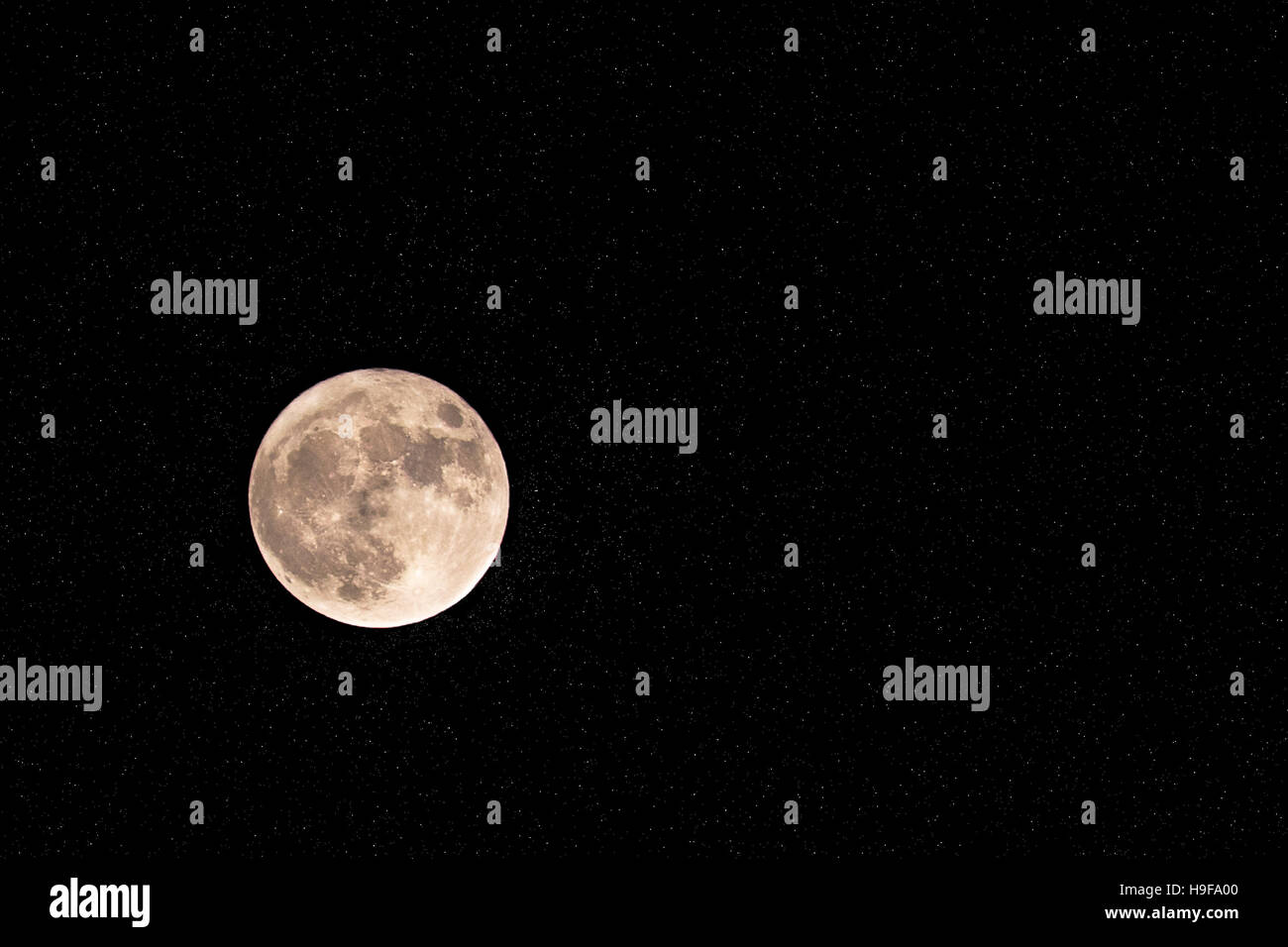 Big moon surrounded by millions of bright stars. - Stock Image