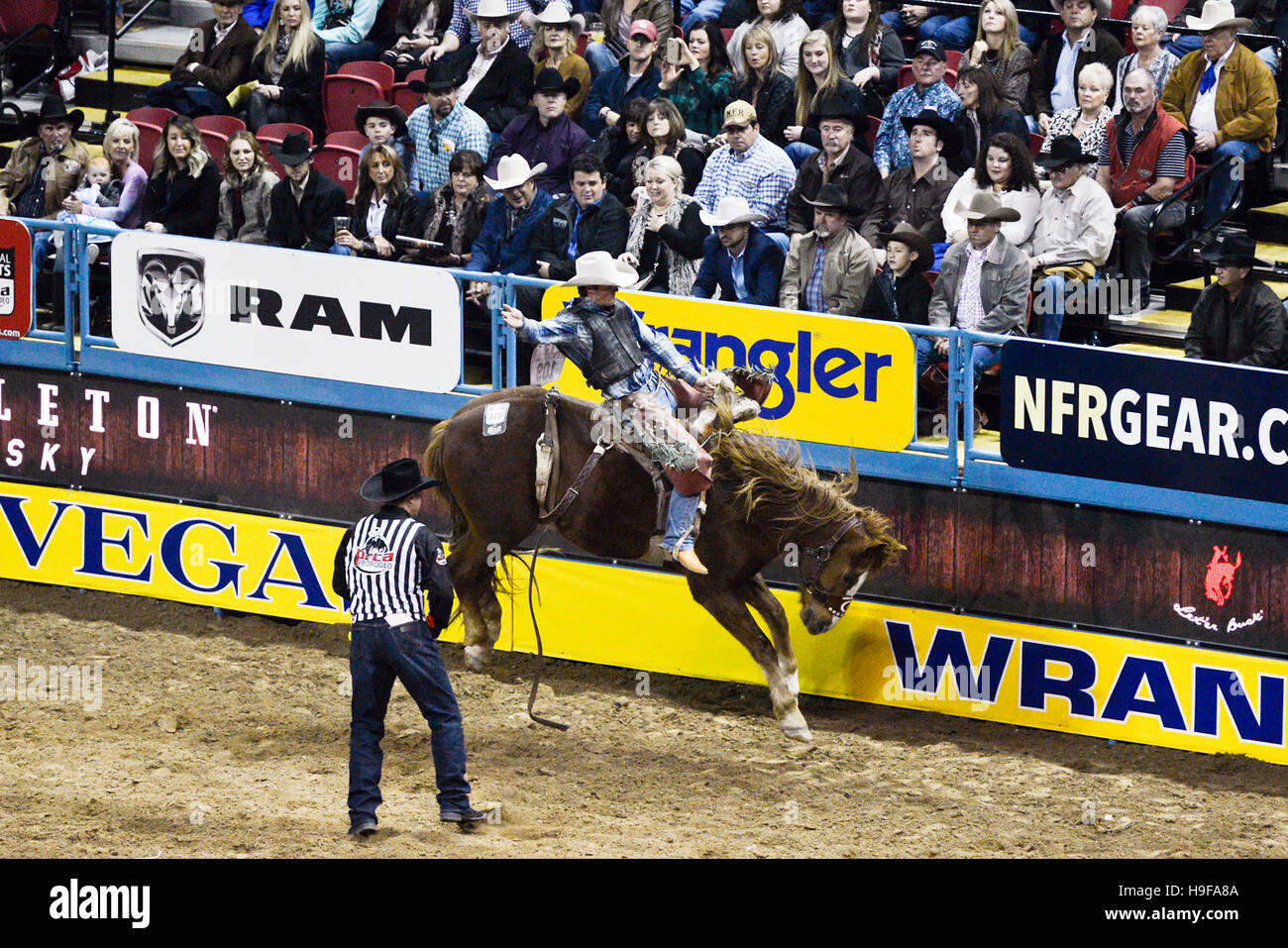 Las Vegas Nevada, December 2015 - Bronco riding at the National Rodeo Finals NFR - Stock Image