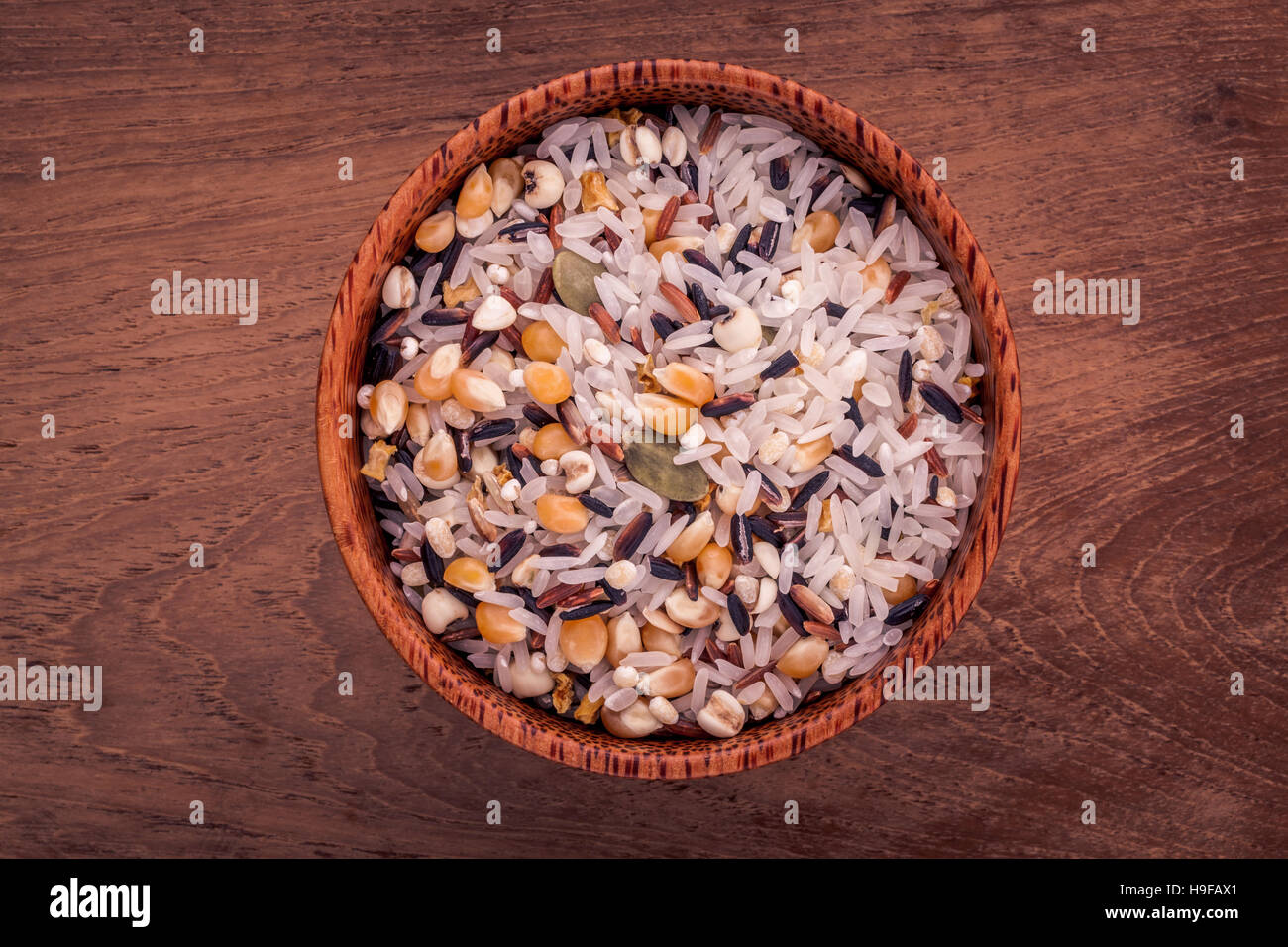 Mixed Whole grain Traditional Thai rice in the spoon and bowl be Stock Photo