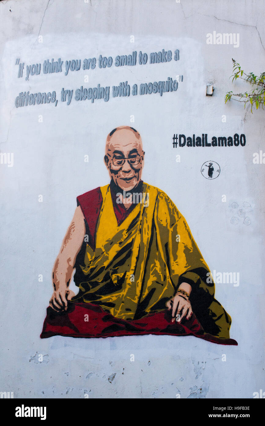 Graffiti on white wall representing the Dalai Lama by Panos Antonopoulos. Painted outside Tibet Society offices, - Stock Image