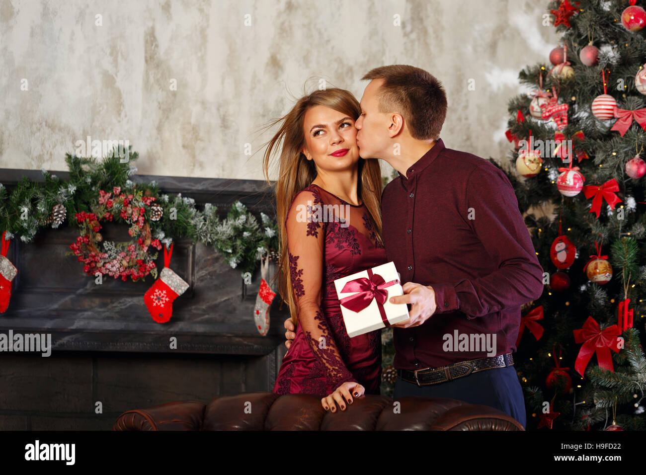 Loving couple and Christmas. Man kissing his girlfriend in gratitude ...
