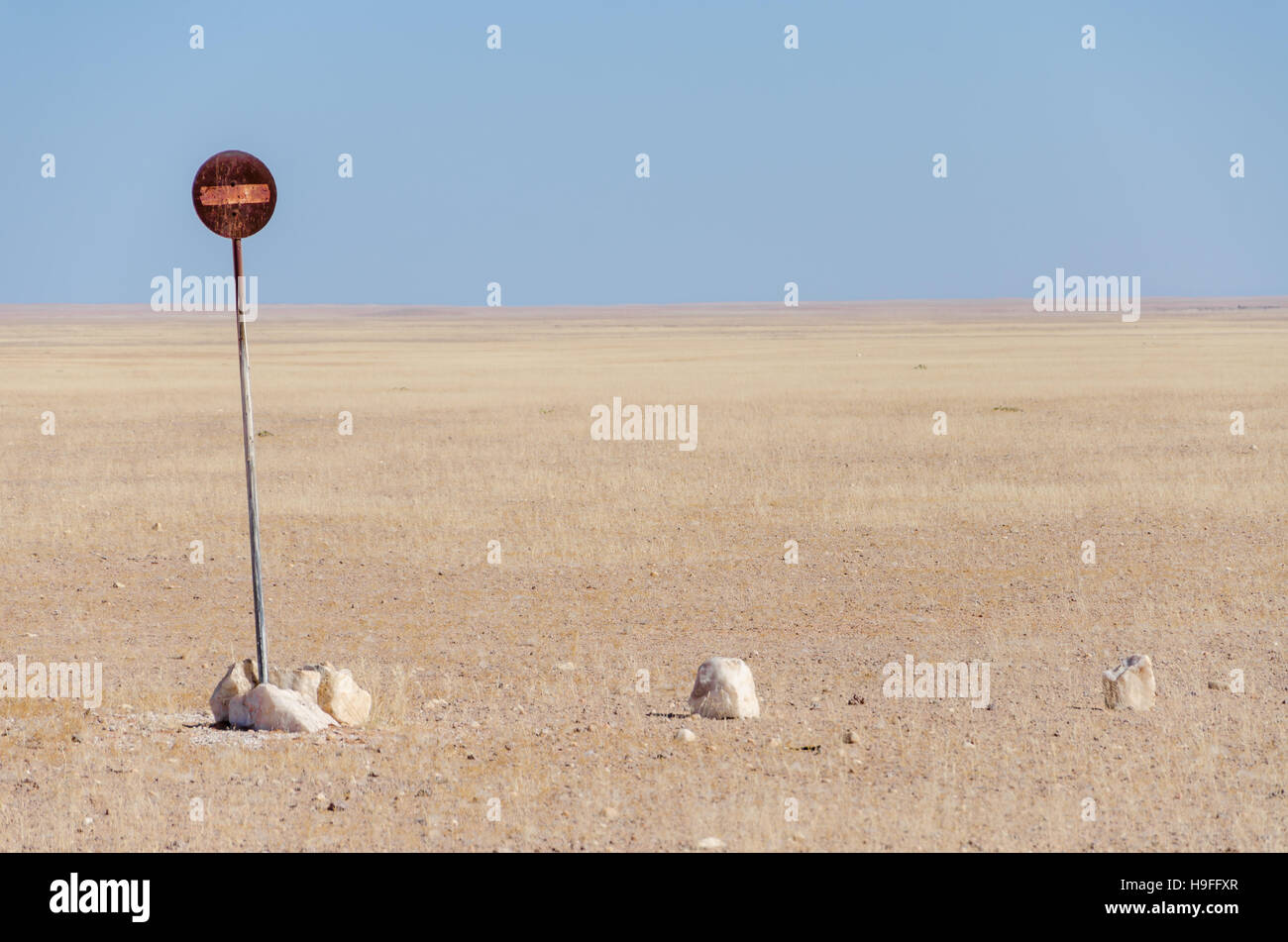 No entry or passage prohibited sign in the middle of the Namib Desert isolated in front of blue sky - Stock Image