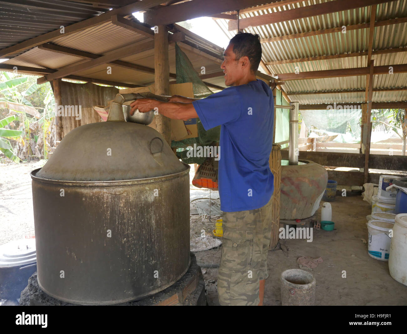 Cambodia, Stung Treng. Making alcohol with a still. Sean Sprague photo - Stock Image