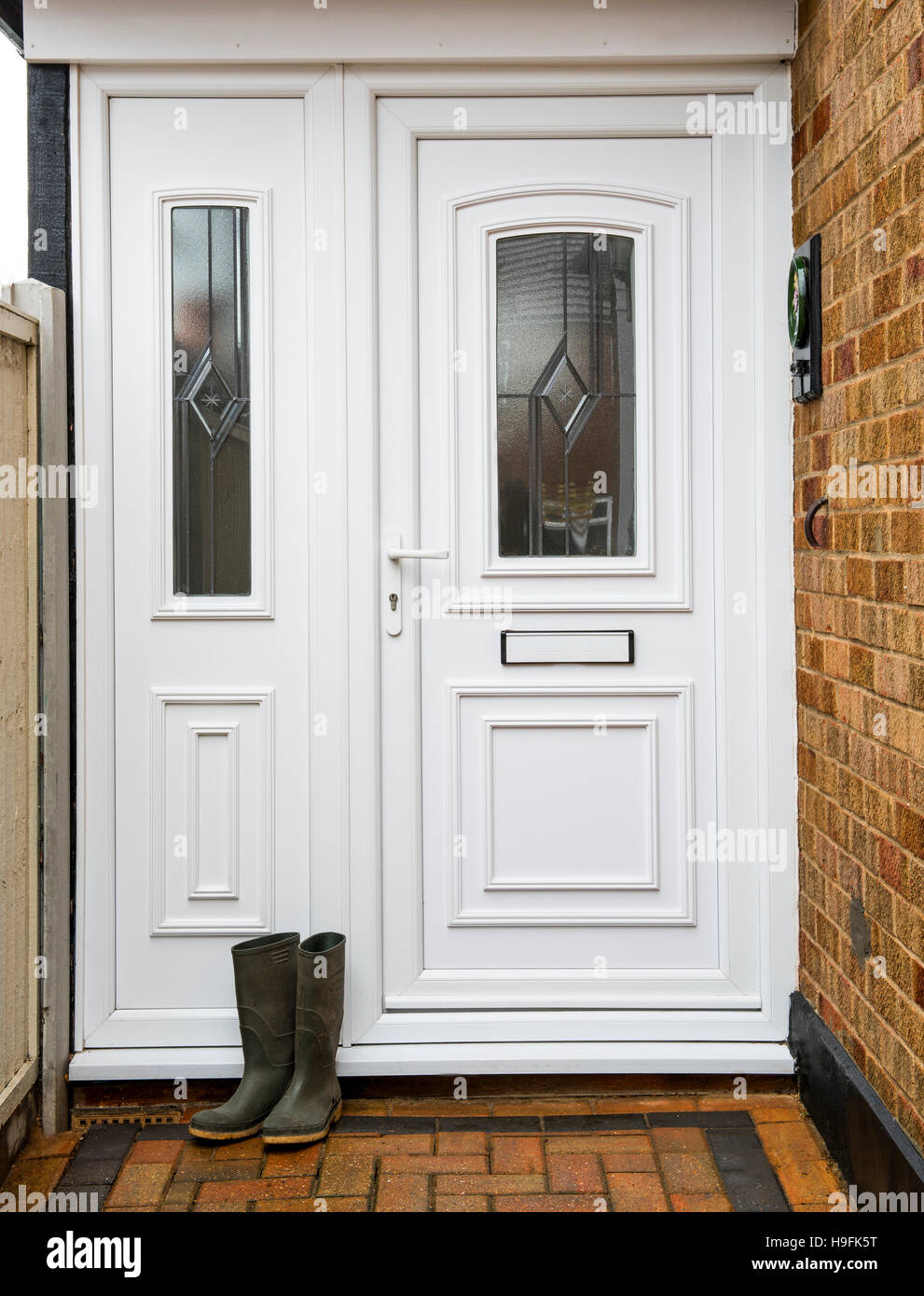 Pair of wellington boots by front door. Stock Photo