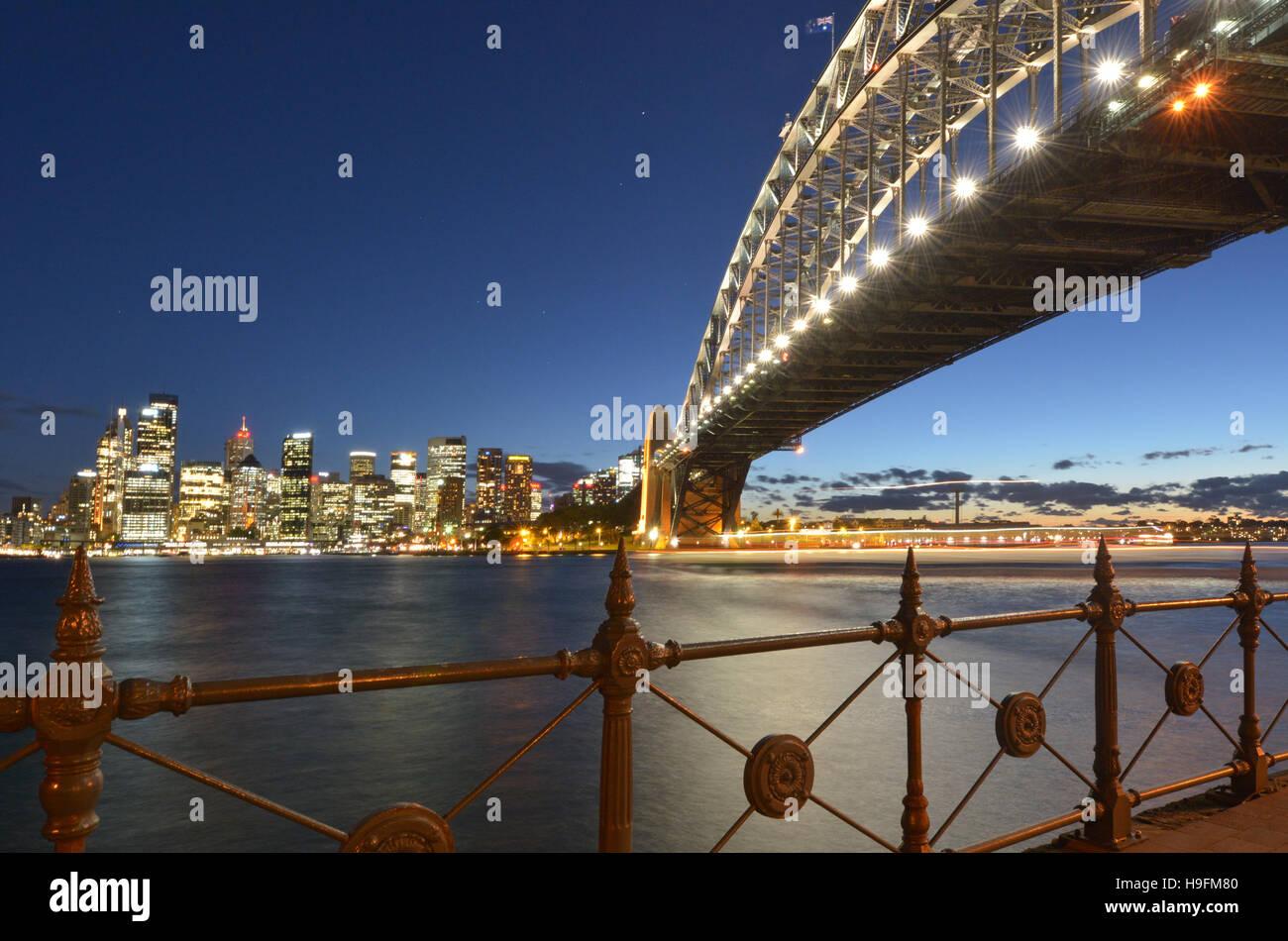 Sydney Harbour Bridge east side and Sydney Skyline, Australia during sunset. - Stock Image