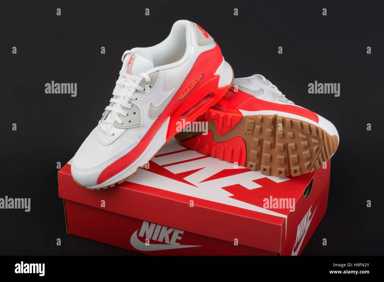 82764632 BURGAS, BULGARIA - AUGUST 29, 2016: Nike Air MAX lady's - women's shoes -  sneakers - trainers, in white and orange, illustrative editorial