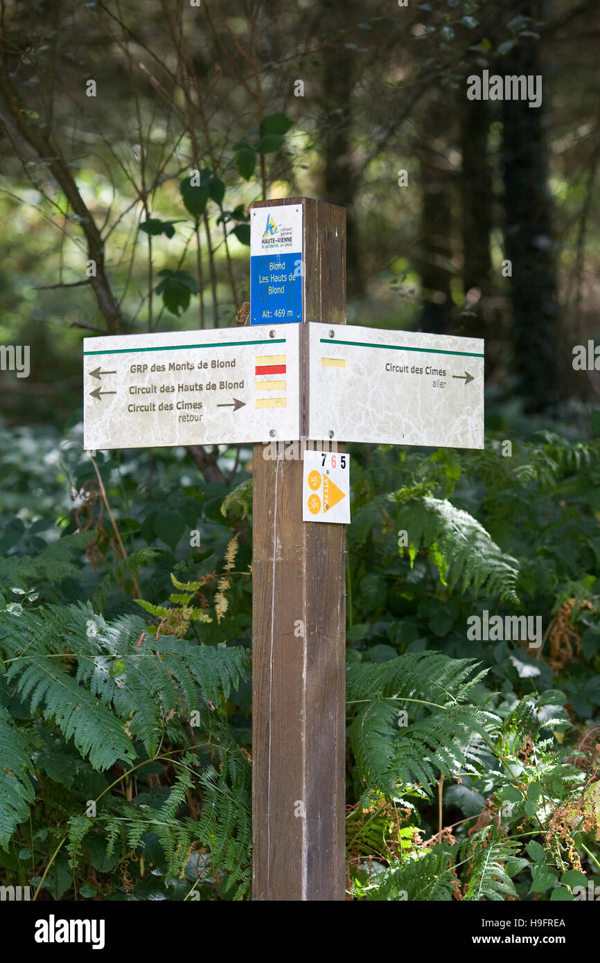 Signpost marking walking routes around Blond, France. - Stock Image