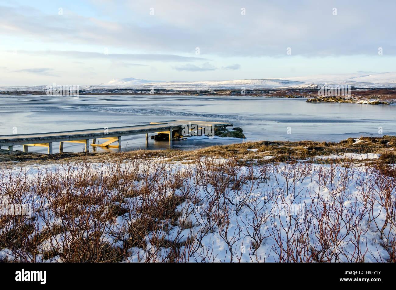 Deserted fishing pier winter at Thingvallavatan  Lake, Iceland Golden Circle Tour Thingvellir (Þingvellir) - Stock Image
