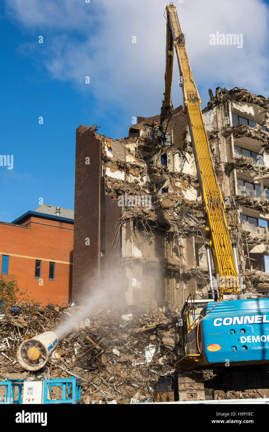 Demolition work with water spray cannon for dust suppression, Telegraph House, Rochdale, Greater Manchester, England, - Stock Image