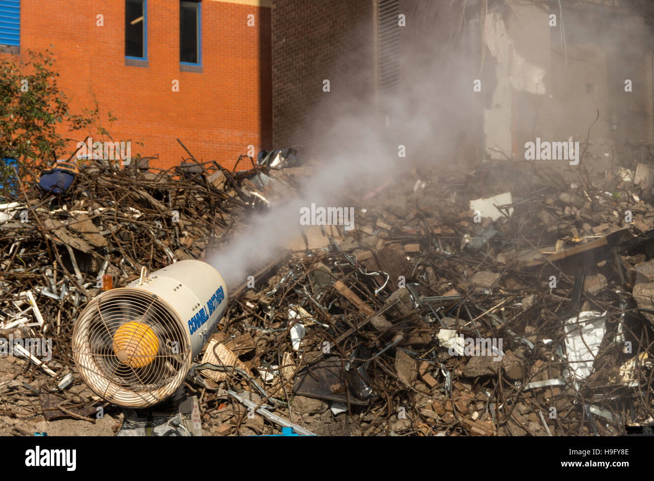 Water spray cannon for dust suppression, demolition of Telegraph House, Rochdale, Greater Manchester, England, UK. - Stock Image