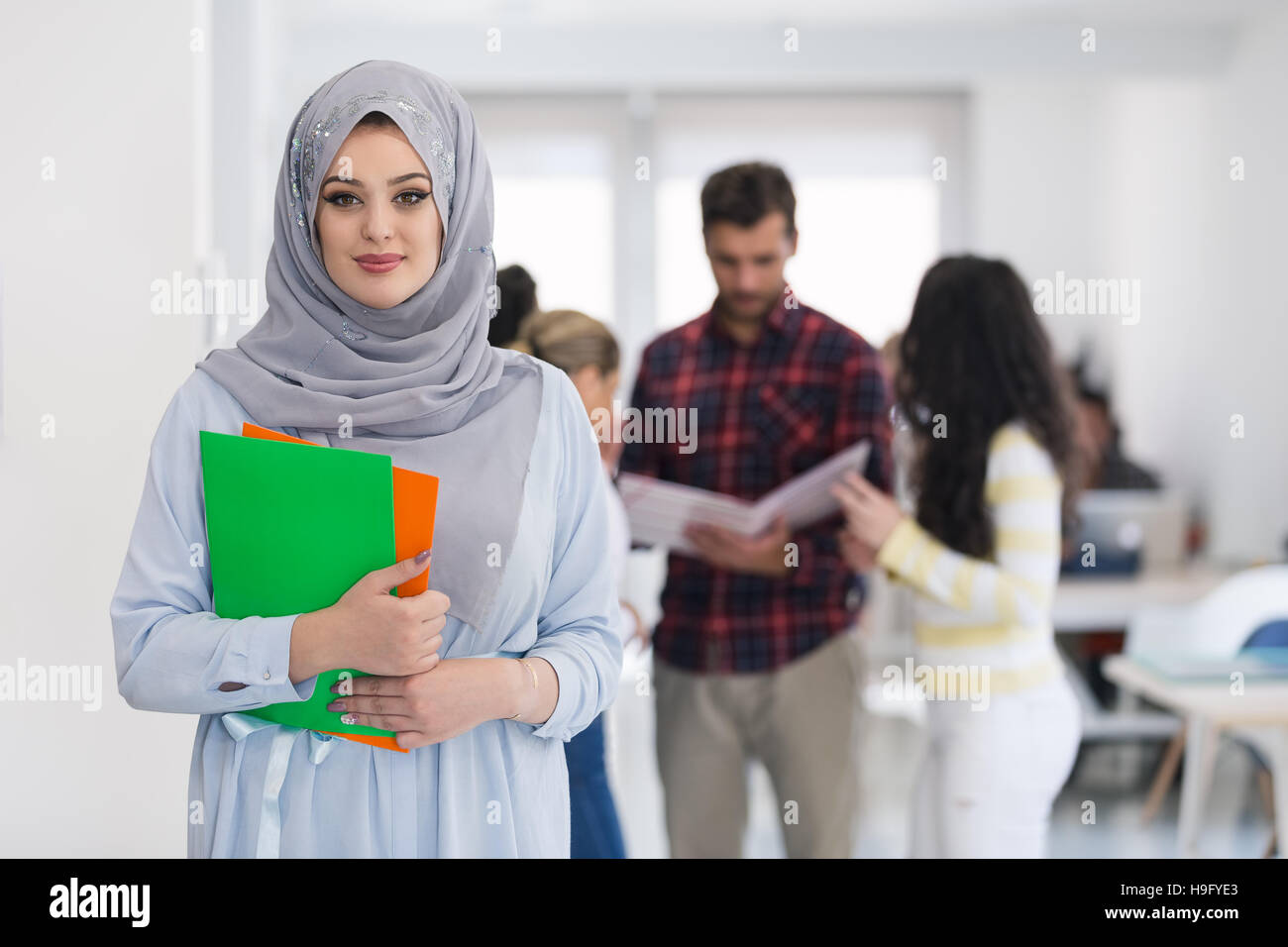 Arabic business woman working in team - Stock Image