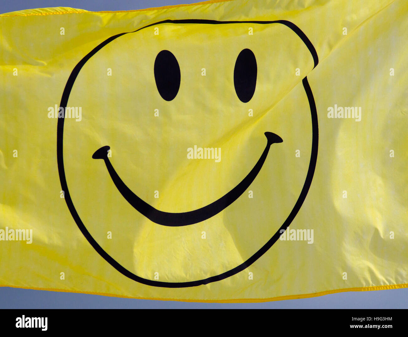 Smiley faced flag Fort Myers beach Florida USA - Stock Image