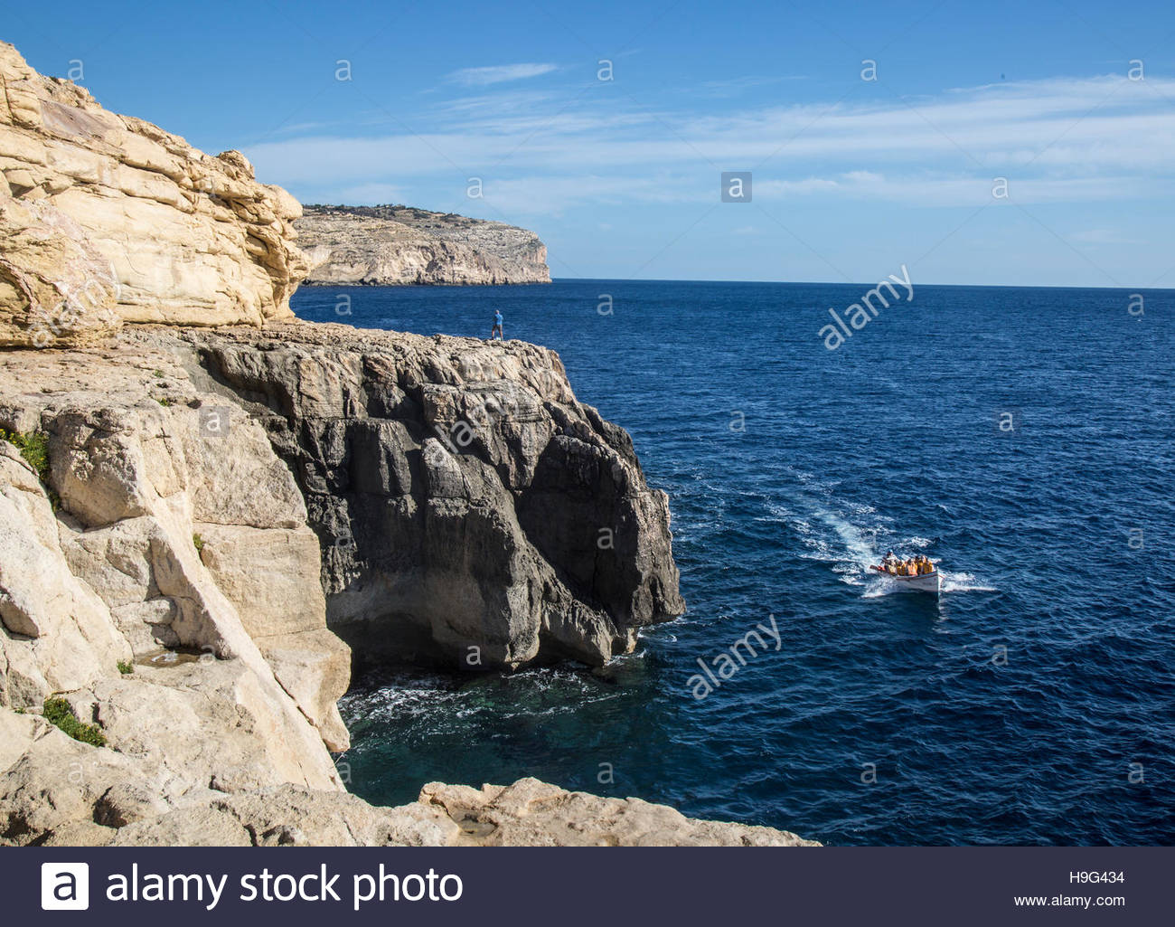 Boat with Blue Grotto sightseers returning to harbour. - Stock Image