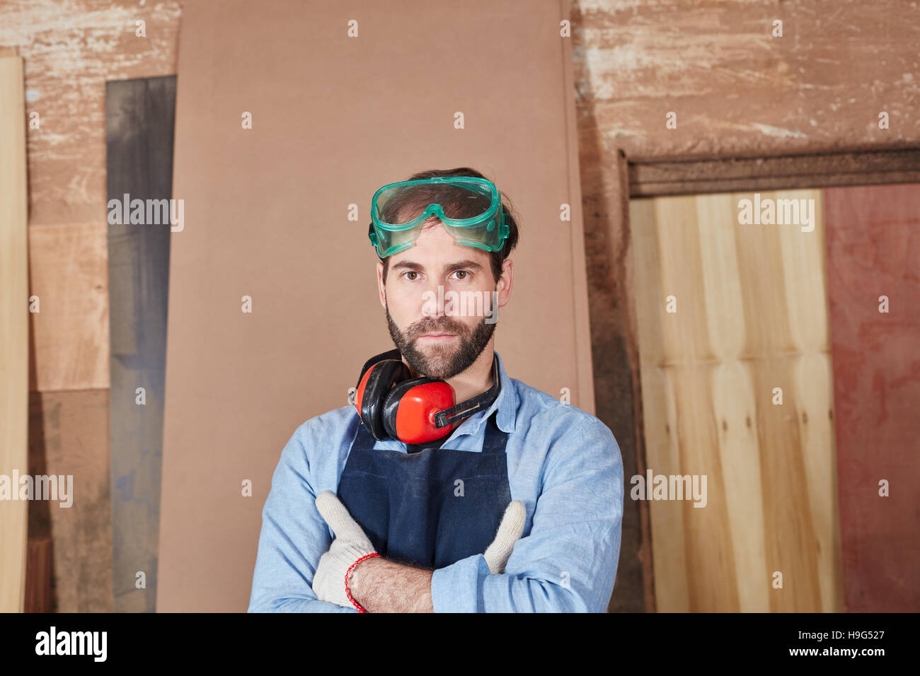 Man as artisan with arms crossed looking confident - Stock Image