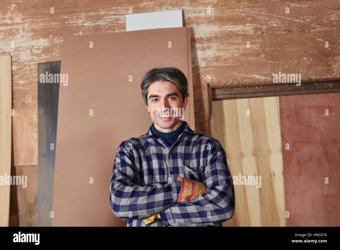 Man as woodworker or craftsman looking content - Stock Image
