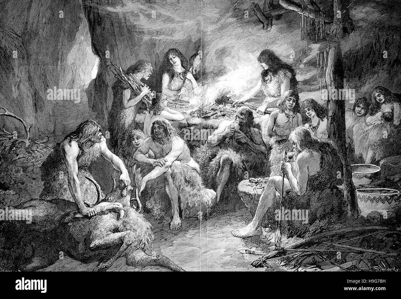Life and activity of prehistoric people, cave dwellers in the Stone Age - Stock Image