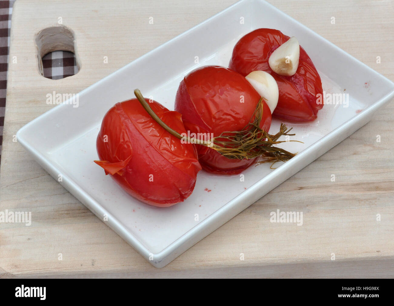 Preserved ripe tomatoes in the Slavic style - Stock Image