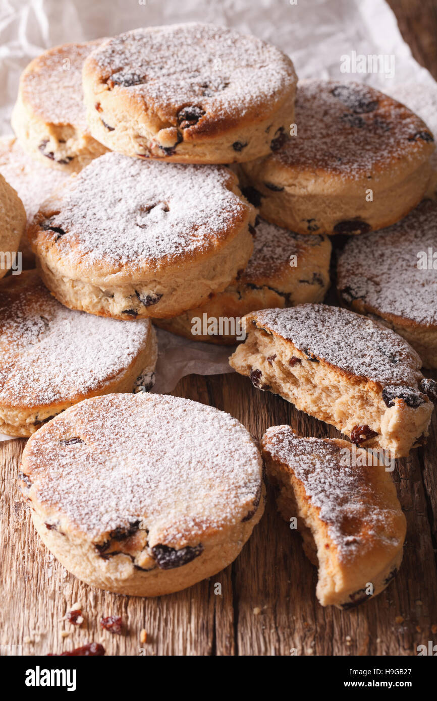 British biscuits: Welsh cakes with raisins and powdered sugar close-up on the table. Vertical - Stock Image