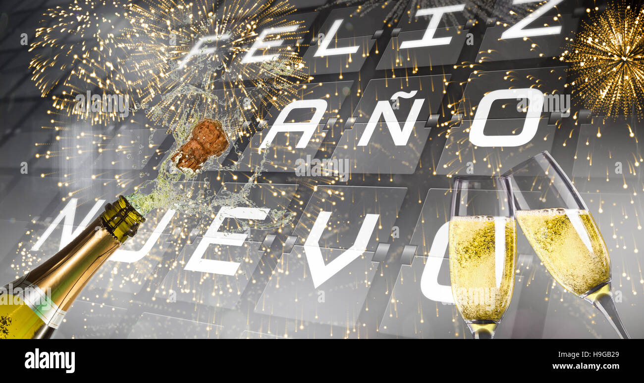 Composite image of champagne popping - Stock Image