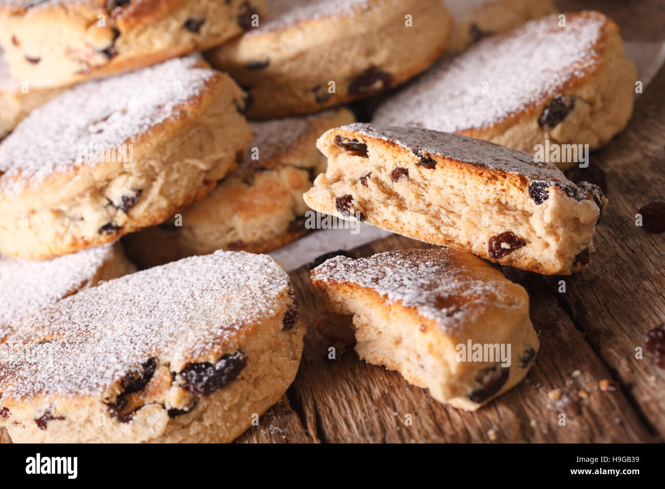 Traditional Welsh cakes with raisins and powdered sugar macro on the table. Horizontal - Stock Image