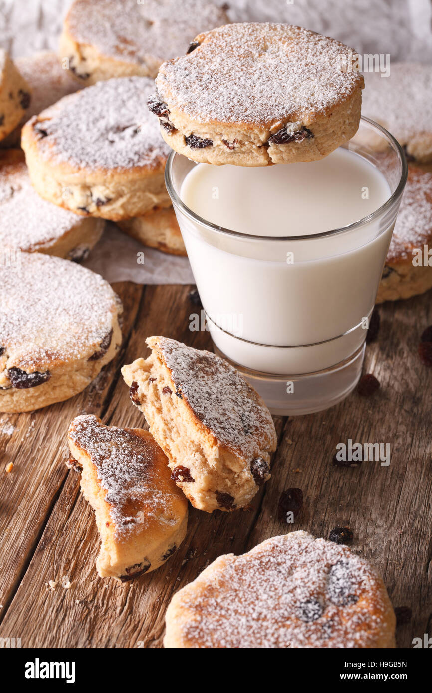 Traditional Welsh cakes with raisins and milk on the table close-up. vertical - Stock Image