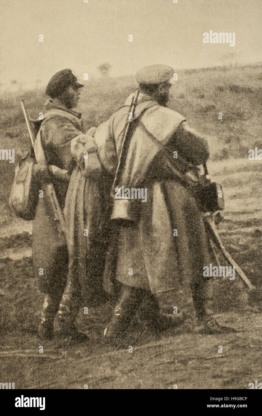 Russo-Japanese War (1904-1905). Skirmish at Shaho on December 10, 1904. Russian soldiers carrying a wounded comrade. - Stock Image