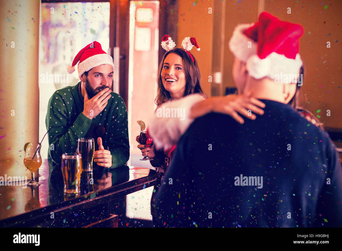 Composite image of festive friends having fun together - Stock Image