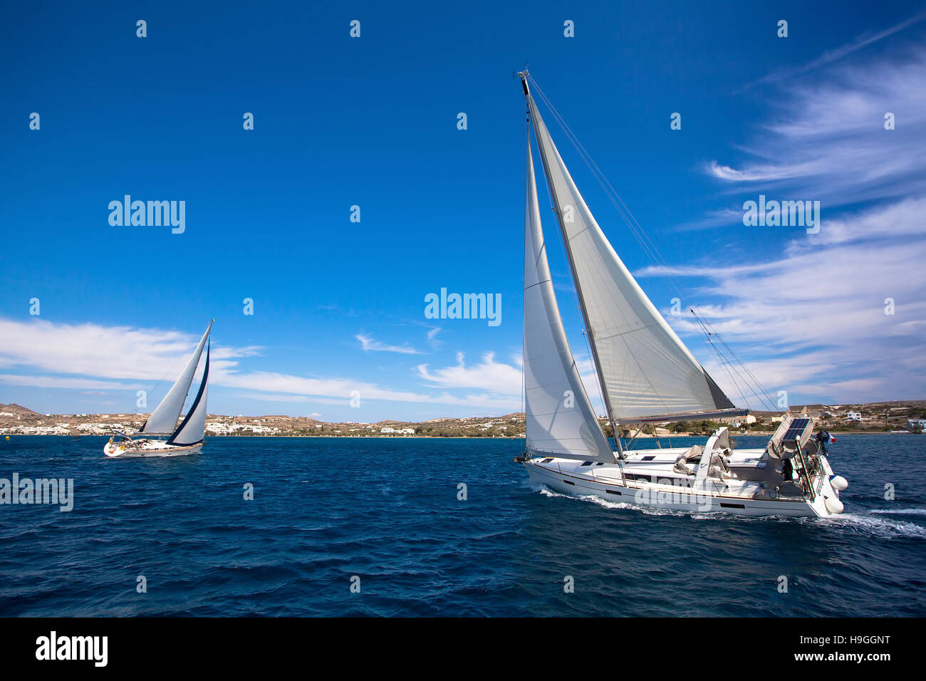 Luxury yachts at Sailing regatta in the wind through the waves at the Mediterranean Sea. - Stock Image
