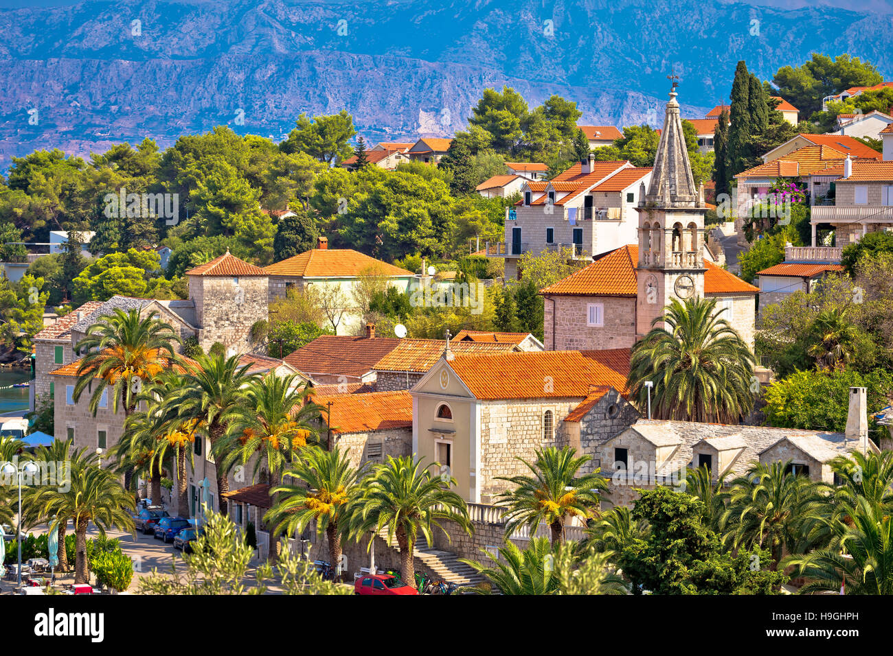 Splitska village stone landmarks in palm trees, island of Brac, Croatia - Stock Image