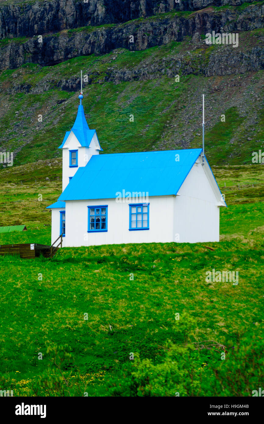 An isolated church in the east fjords region, Iceland - Stock Image