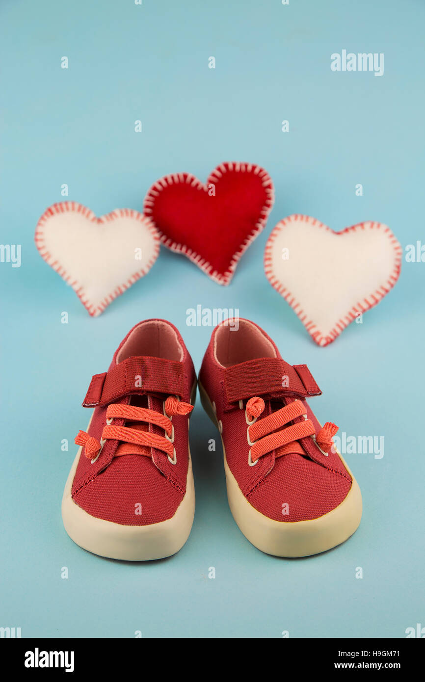 portrait of little girl shoes with hearts - Stock Image