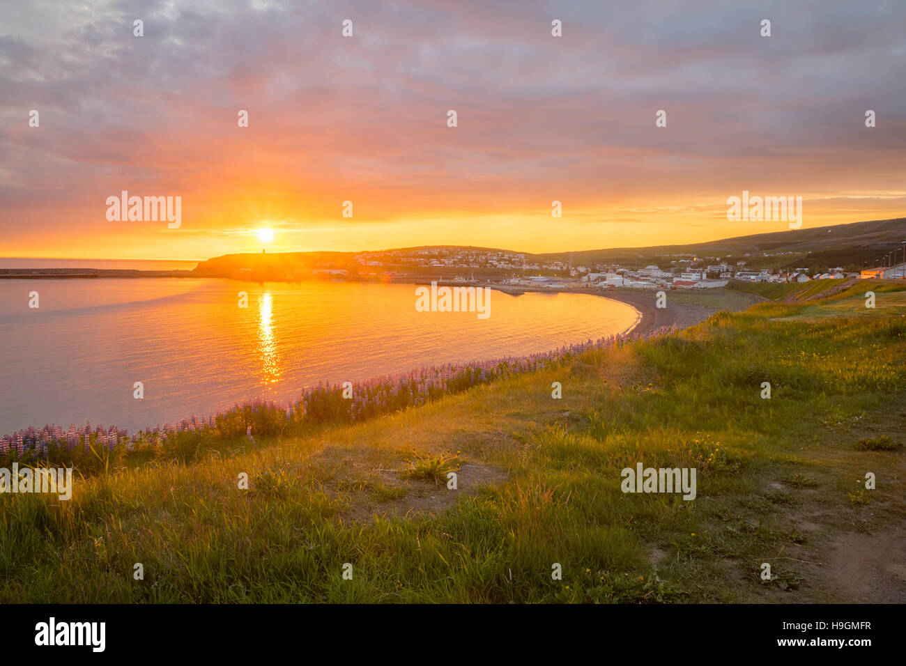 Sunset view of the fishing town Husavik, northeast Iceland - Stock Image