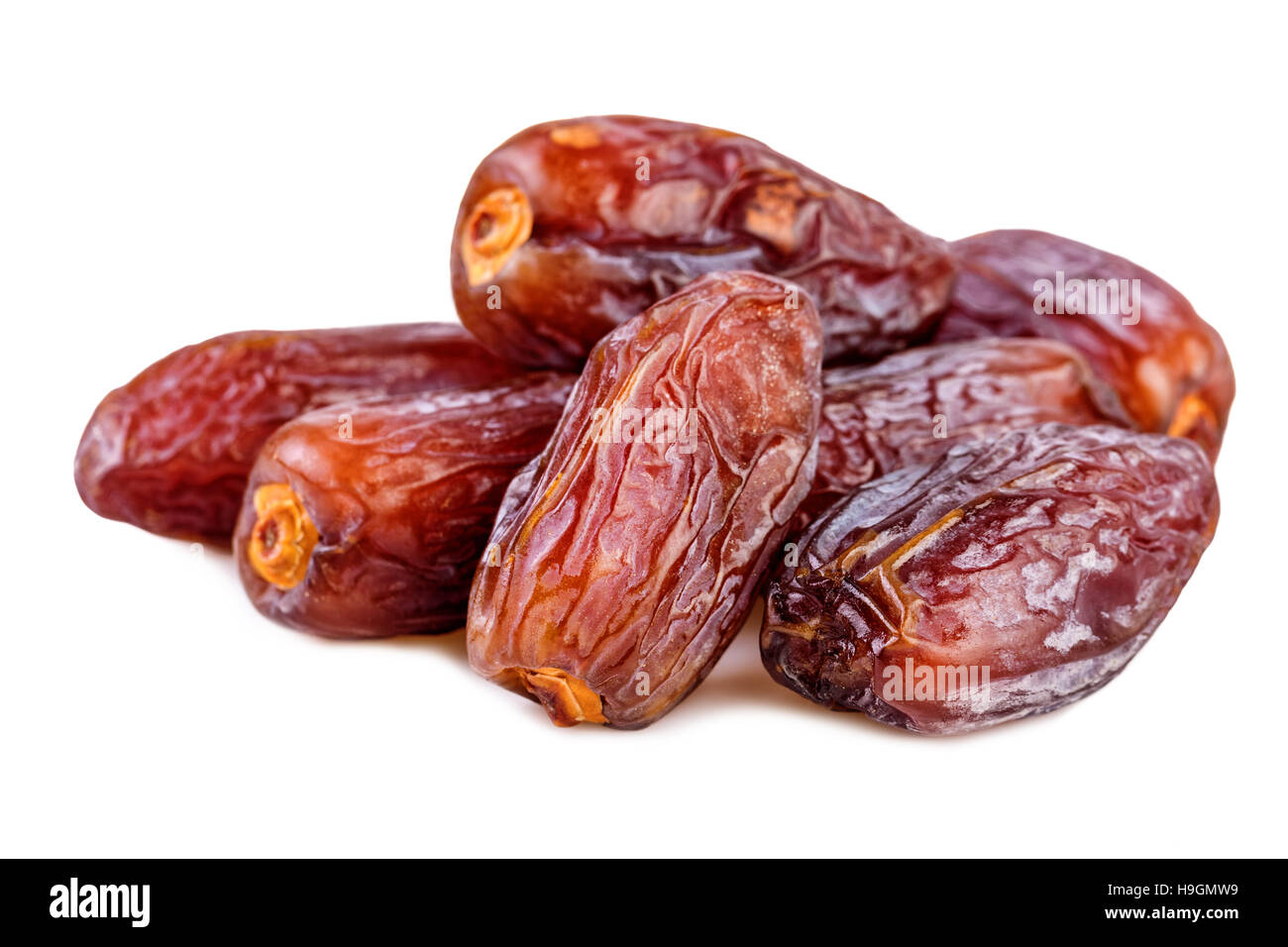 heap of dried dates over white - Stock Image