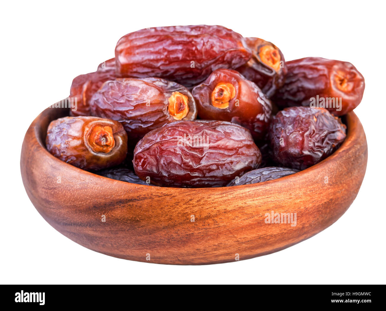 Dried dates. Bowl with dry dates isolated on white - Stock Image