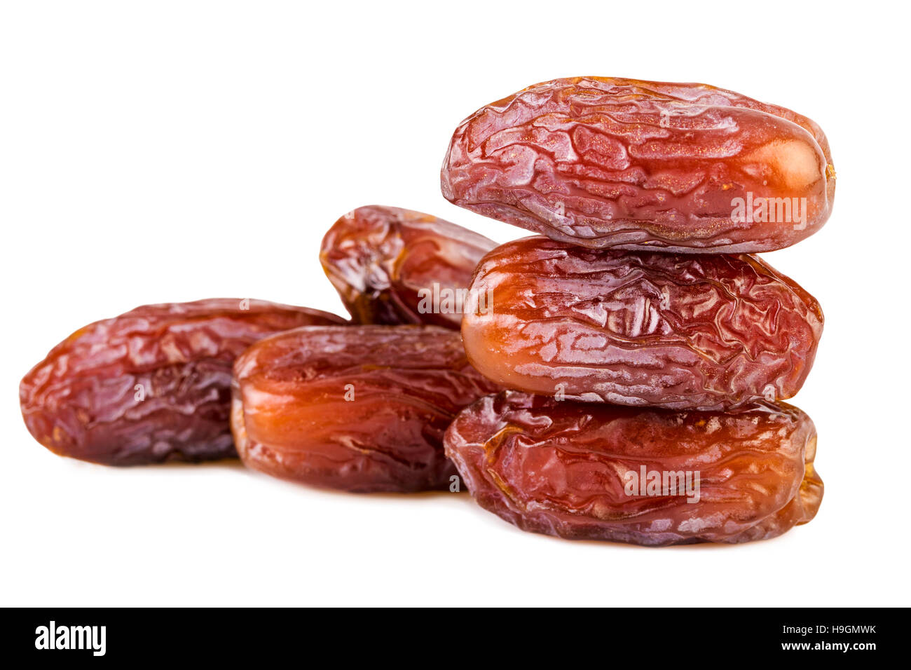 sweet dried dates pile stack on white - Stock Image