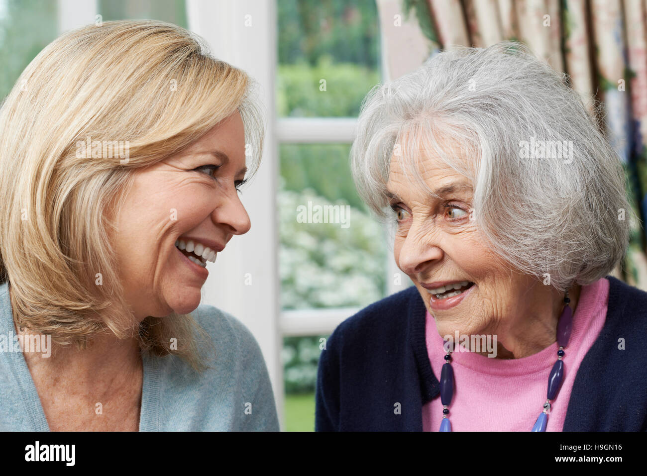 Senior Mother And Adult Daughter Talking Together - Stock Image