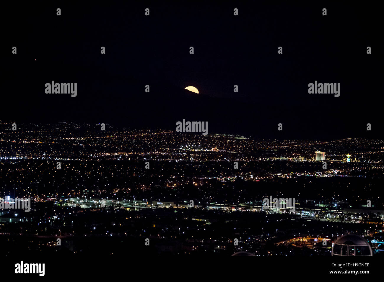 Super moon rising over an aerial view of Las Vegas city at night, Nevada, USA - Stock Image