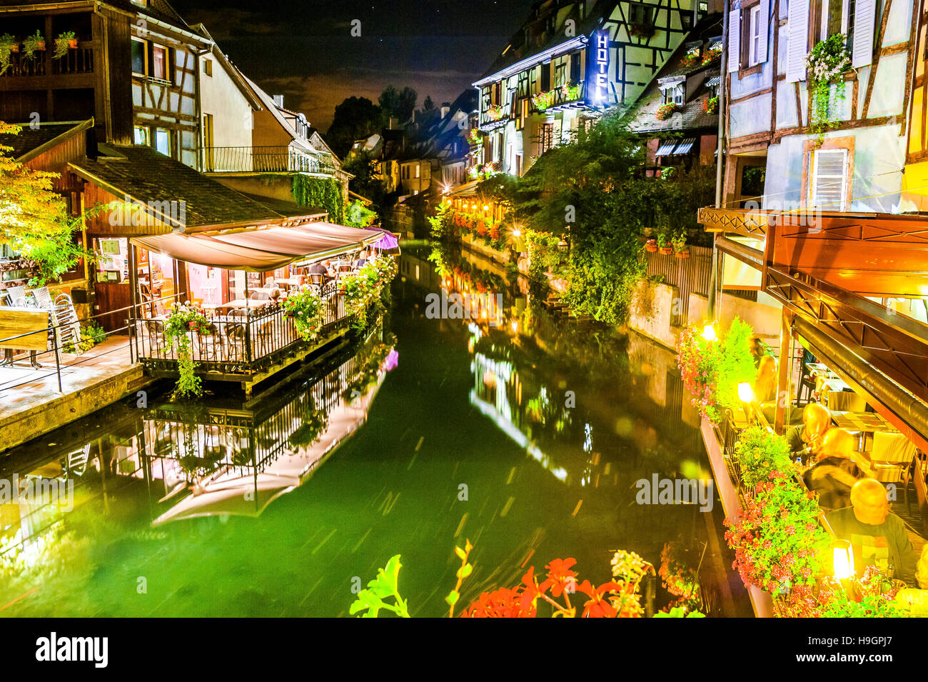 Colmar, scenic picturesque town at night with canal and reflection in the water, part of old town called small Venice, - Stock Image