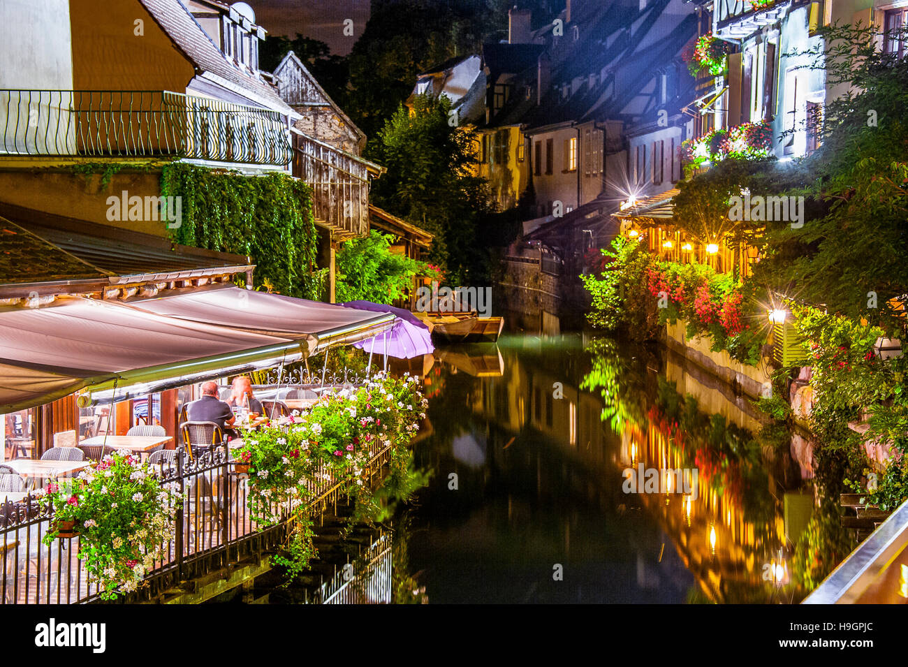 Colmar, scenic picturesque town at night with reflection in a canal, part of old town called small Venice, Alsace, - Stock Image