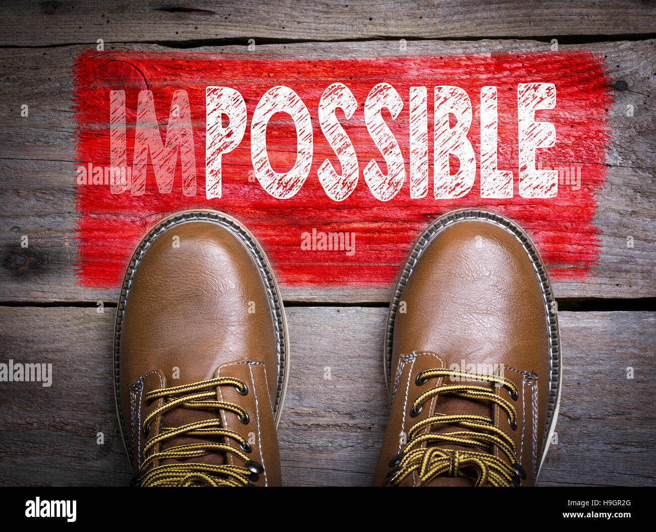 Impossible - Possible. Top View of Boot on wooden background - Stock Image