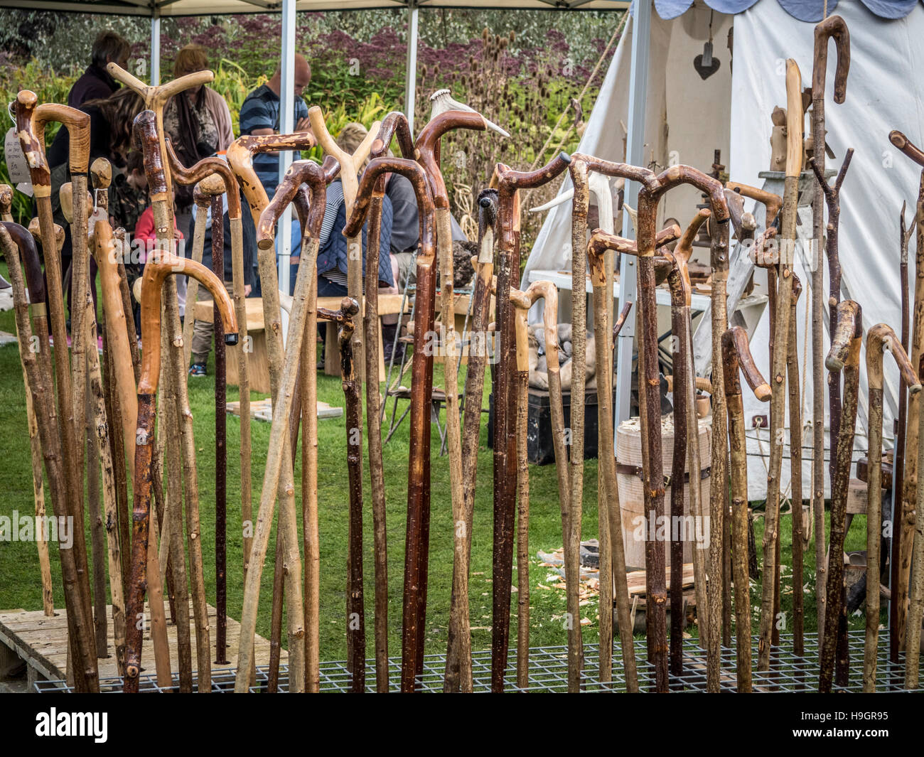 Hand crafted walking sticks for sale at country show - Stock Image