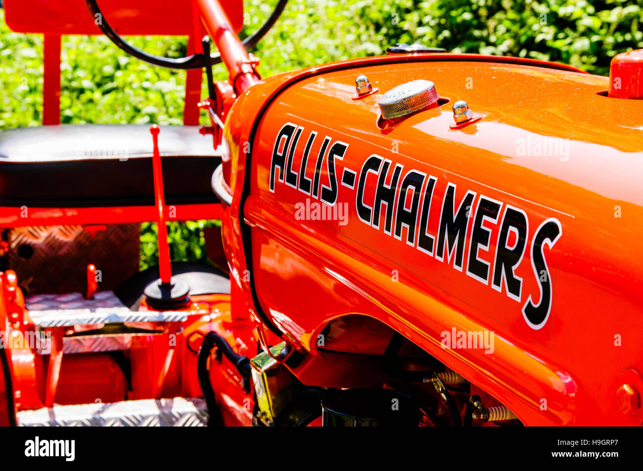 Orange Allis-Chalmers farm tractor from the 1930s - Stock Image