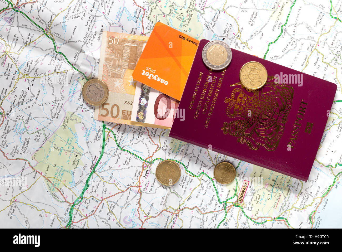 Road Map Of Spain.A British Passport Euro Coins And Notes On A Road Map Of Spain