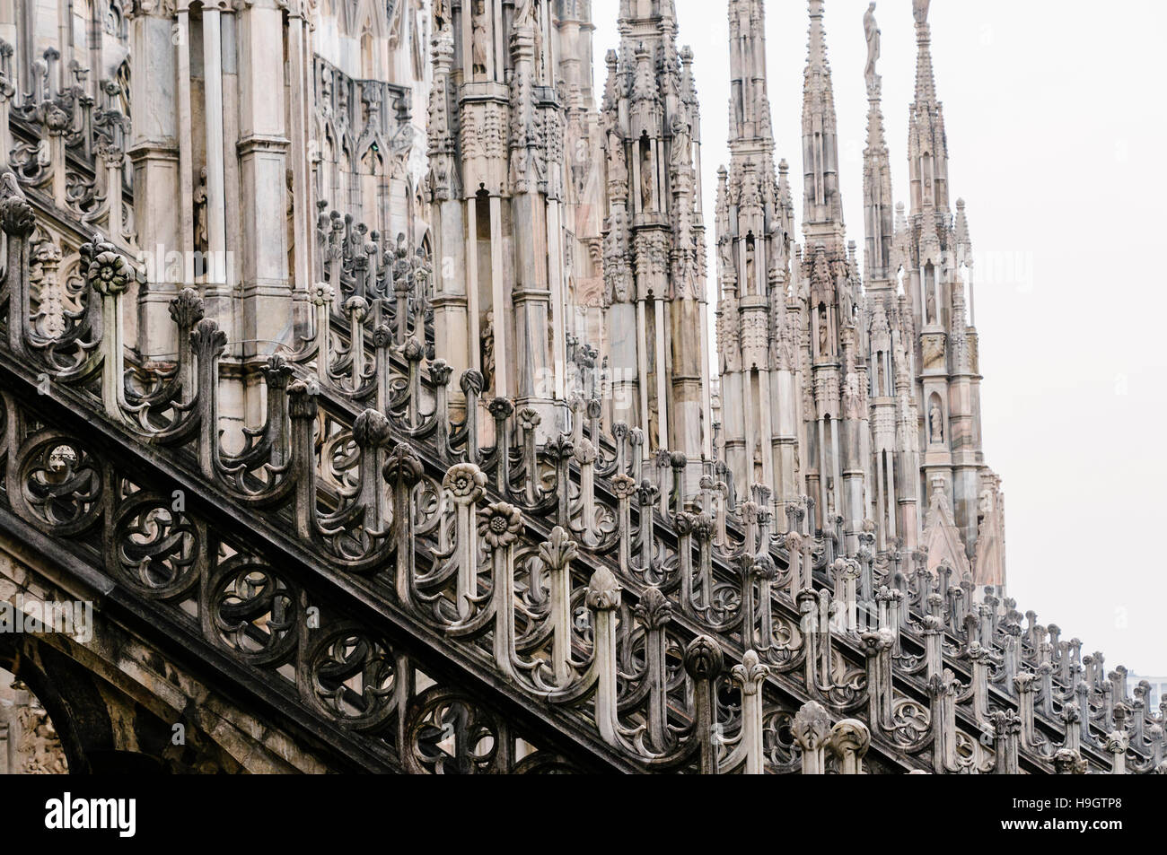 Flying Buttress And Ornately Carved Stonework On The Roof Of Duomo Milano Milan Cathedral Italy