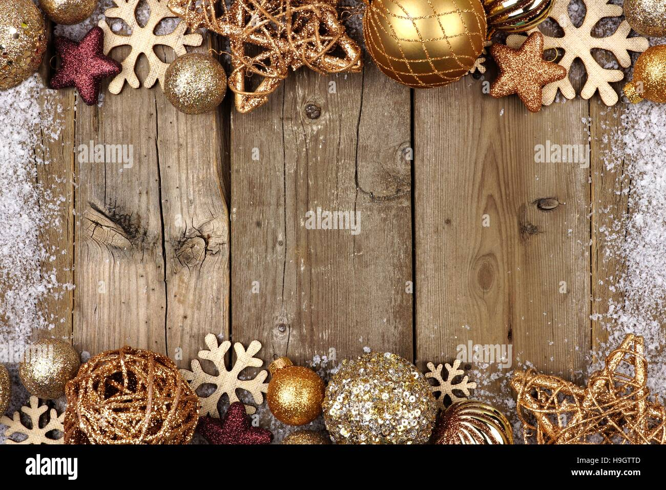 Gold Christmas Ornament Double Border With Snow Frame On A Rustic Wood Background