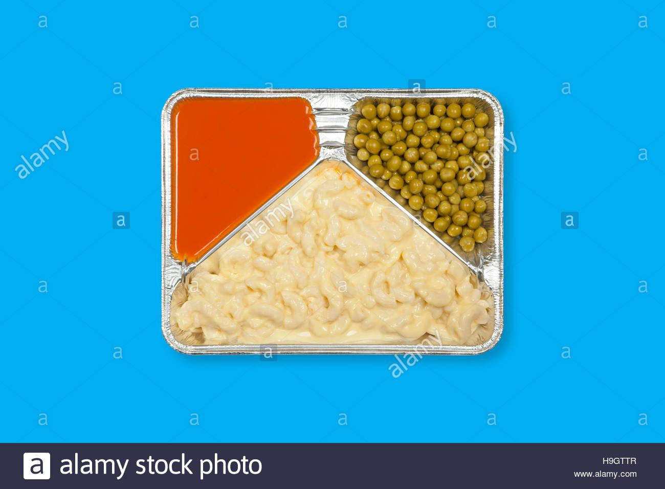 TV dinner tray vintage retro meal aluminum food dish on plain background Stock Photo